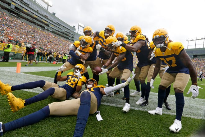 Green Bay Packers players celebrate during the Green Bay Packers 26-16 win over the Denver Broncos last season.