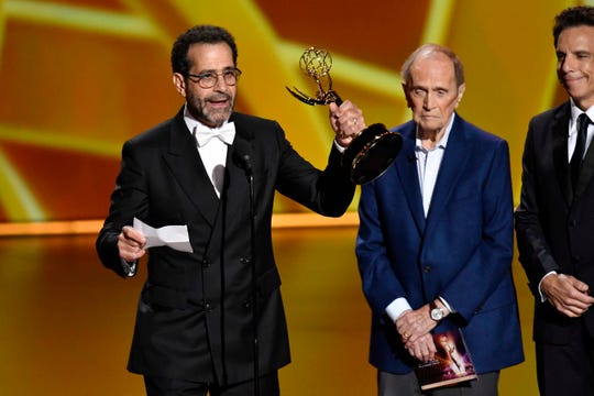 "Tony Shalhoub, left, with Bob Newhart and Ben Stiller watching, accepts the award for supporting actor in a comedy series for his role on ""The Marvelous Mrs. Maisel"" at the 71st Primetime Emmy Awards Sunday night. The award was the fourth Emmy for Shalhoub, a Green Bay native."