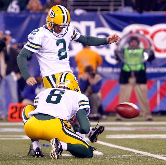Mason Crosby kicks the game winning field goal as time ran off the clock.  The Green Bay Packers defeated the New York Giants 38-35 at MetLife Stadium in East Rutherford N.J. Sunday December 4, 2011.