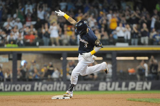 Orlando Arcia gestures as he touches second during his tour around the bases after hitting a solo home run against the Pirates in the second inning.