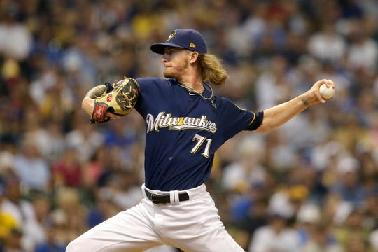 Milwaukee Brewers' Josh Hader pitches during the eighth inning of a baseball game against the Pittsburgh Pirates, Sunday, Sept. 22, 2019, in Milwaukee. (AP Photo/Aaron Gash) ORG XMIT: WIAG116