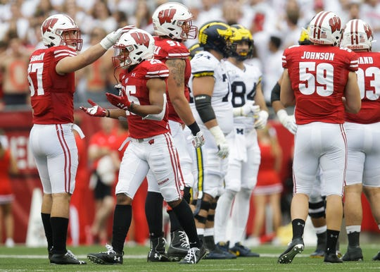 Wisconsin's Eric Burrell  reacts after being flagged for targeting Saturday against the Michigan. He was ejected and also will miss the first half of the Northwestern game, along with fellow Badgers safety Reggie Pearson.