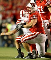 Wisconsin defensive tackle Jordan Kohout (91) celebrates after sacking Nebraska quarterback Taylor Martinez (3) during the first half of an NCAA college football game Saturday, Oct. 1, 2011, in Madison, Wis.