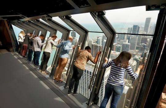 360 Chicago (formerly the John Hancock Building) added Tilt to its 94th floor observation deck. The glass-enclosed viewing platform leans eight tourists at a time at a 30-degree angle 1,000 feet out over the city.
