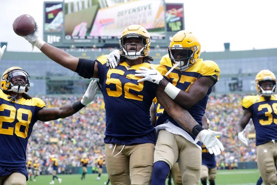 Green Bay Packers linebacker Rashan Gary (52) holds the ball after a fumble by Denver Broncos quarterback Joe Flacco (5)  during the Green Bay Packers vs. Denver Broncos game Sunday. September 22, 2019 at Lambeau Field in Green Bay, Wis.