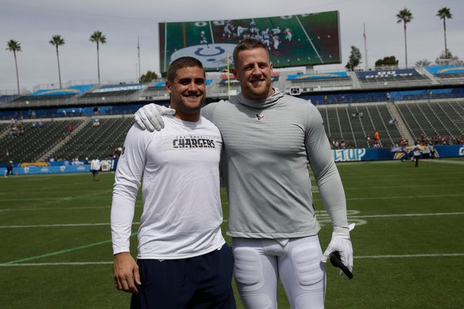 Los Angeles Chargers fullback Derek Watt, left, and Houston Texans defensive end J.J. Watt pose before a Week 3 game Sunday, Sept. 22, 2019, in Carson, California. The Texans defeated the Chargers, 27-20.