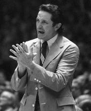 Al McGuire, then Marquette basketball coach, shouts to his team during their NCAA semifinal game against Kansas in Greensboro, N.C., on March 23, 1974.