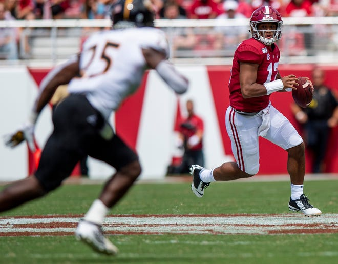Alabama quarterback Tua Tagovailoa (13) scrambles for yardage against Southern Miss at Bryant-Denny Stadium in Tuscaloosa, Ala., on Saturday September 21, 2019.