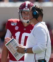 Alabama quarterback Mac Jones (10) talks with offensive coordinator Steve Sarkisian during the Southern Miss game at Bryant-Denny Stadium in Tuscaloosa, Ala., on Saturday September 21, 2019.