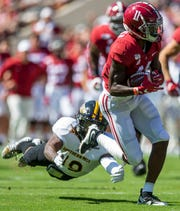 Alabama wide receiver Henry Ruggs, III, (11) pulls away from Southern Miss defensive back Ky'el Hemby (19) on Rugg's first touchdown of the game at Bryant-Denny Stadium in Tuscaloosa, Ala., on Saturday September 21, 2019.