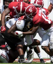Alabama linebacker Christopher Allen (4) and defensive back Xavier McKinney (15) stop Southern Miss running back Kevin Perkins (33) at Bryant-Denny Stadium in Tuscaloosa, Ala., on Saturday September 21, 2019.