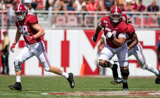 Alabama tight end Major Tennison (88) and offensive lineman Jedrick Wills, Jr., (74) blocking against Southern Miss at Bryant-Denny Stadium in Tuscaloosa, Ala., on Saturday September 21, 2019.