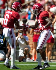 Alabama wide receivers DeVonta Smith (6) and Henry Ruggs, III, (11) celebrate after Ruggs' second touchdown against Southern Miss at Bryant-Denny Stadium in Tuscaloosa, Ala., on Saturday September 21, 2019.