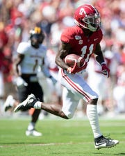 Alabama wide receiver Henry Ruggs, III, (11) scores an early touchdown against Southern Miss at Bryant-Denny Stadium in Tuscaloosa, Ala., on Saturday September 21, 2019.