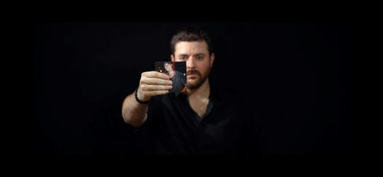 "Chris Young released the emotional video for his deeply personal song ""Drowning"" on Monday, Sept. 23."