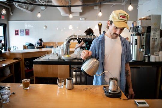 Barista Jesse Lendzion works on making an iced tea at Steadfast Coffee in Nashville, Tenn., Monday, Sept. 23, 2019.