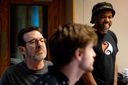 "Victor Wooten, right, works with producers to record Luke Putney's song at Ocean Way Nashville Studio Monday, Aug. 19, 2019, in Nashville, Tenn. Putney recorded a song he wrote called ""Cape Town"" and will walk the equivalent of a marathon to fundraise for charity providing music education in Cape Town, South Africa."