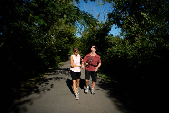 Luke Putney and Nancy Hoddinott practice walking at Shelby Park on Wednesday, Aug. 28, 2019, in Nashville, Tenn. Putney plans to walk a mile every day for the equivalent of a marathon as a way to raise money for his charity after being unable to walk for a long period of time.