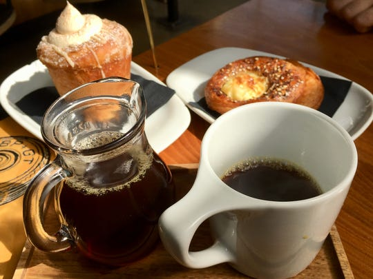 Coffee, a brioche cinnamon roll and an everything croissant at Barista Parlor in Germantown.