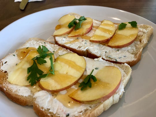 West Nashville's 8th & Roast features more menu items than the original location. Here's honey-drizzled crispy apple slices and whipped ricotta on toast.