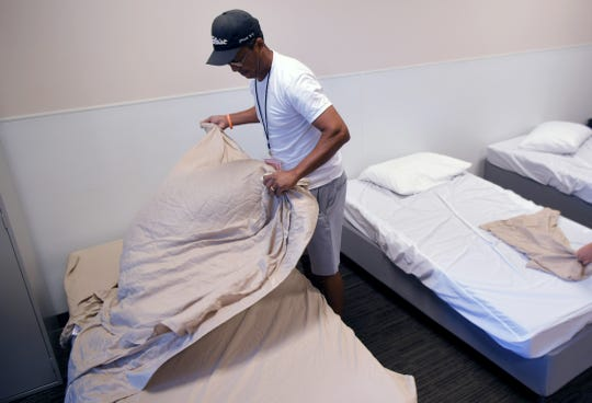 Williamson County Homeless Alliance worker and shelter monitor Mervin Shepard sets up beds for an emergency shelter was held at Franklin First United Methodist Church in Franklin on August 21, 2019.