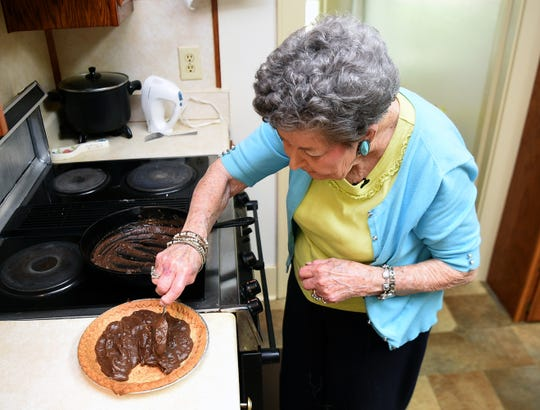 Dorothy Elkins, 93, fills homemade pie shell with her home-cooked chocolate filling in her kitchen in Bell Buckle.