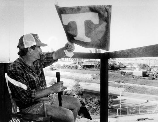 Nashville radio personality Duncan Stewart waves his Tennessee Vols flag while doing his WSIX talk show from atop a billboard on Division Street on Sept. 20, 1988. He won't come down until the 0-3 Volunteers win their first game.