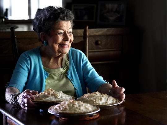 Dorothy Elkins, 93, makes a chocolate meringue pie in her kitchen in Bell Buckle, Tennessee, on Wednesday, Sept. 18, 2019.