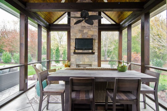The Russell family in Franklin wanted outdoor entertaining space, so they added on this screened porch and patio area. The space was designed by Jennifer Smith of JLS Desgins and built by John Ligon and Associates.