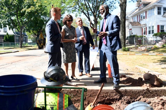 Kareem Adeem, far right, holds a lead pipe that was taken from underneath Keer avenue where the city is replacing the lead pipes with copper piping that lead to residents' homes on Monday, Sept. 23, 2019, in Newark. Adeem is the acting director of the Department of Water and Sewer Utilities for the city of Newark.