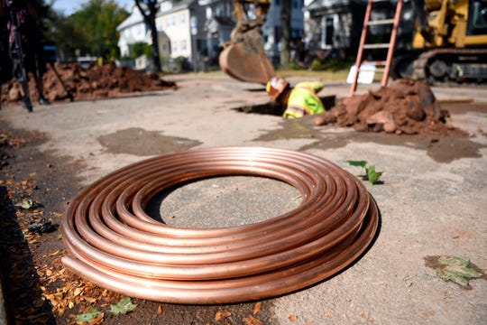 Copper piping lays on Keer Avenue where it will soon go underground to replace lead pipes that feed into residents' homes on Monday, Sept. 23, 2019, in Newark.