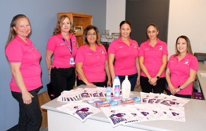From left, Deming High School Counselors Heather Tharp, Joli Zumwalt, Yvonne Jasso Perales, and Luz Chavez, registrar; along with counselor Edith Chavez and secretary Tricia Carreon began a Care Drive to collect personal hygiene products for students in the district.