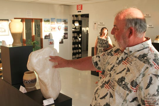 Artist and Clay Time Pottery and Ceramics owner Hank Hangsleben talks about his own artwork, which was displayed at a new fine arts gallery on Sept. 20.