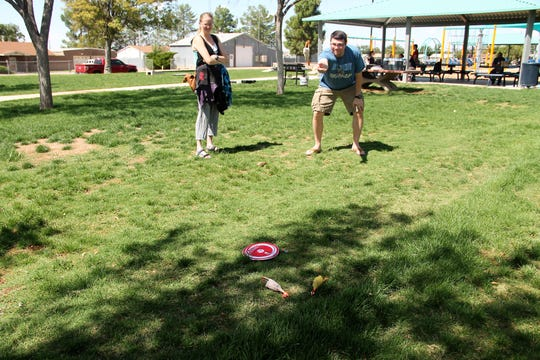 "One of the games at the Stack Up! Alamogordo Barbecue was yard game ""Flickin' Chickens."" The Stack Up! Alamogordo group held one its periodic meet-ups at Kids Kingdom Sunday, Sept. 23. The event was a barbecue and games including role playing and yard games."