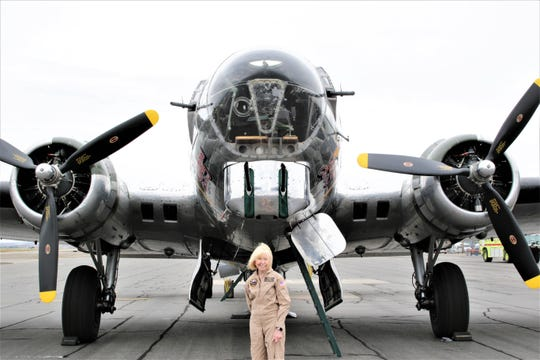 "Sue Shepherd of Flying Legends of Victory Tour stands in front of ""Sentimental Journey."""