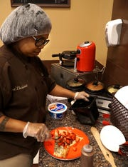 T'Andra Stewart finishes up making a Nutella crepe with strawberries, caramel sauce and whipped cream at her Laurel Park Place Tee' Licious shop on Sept. 23. Stewart will be making some of her chocolate goodies at the upcoming Chocolate Affair on Oct. 6.