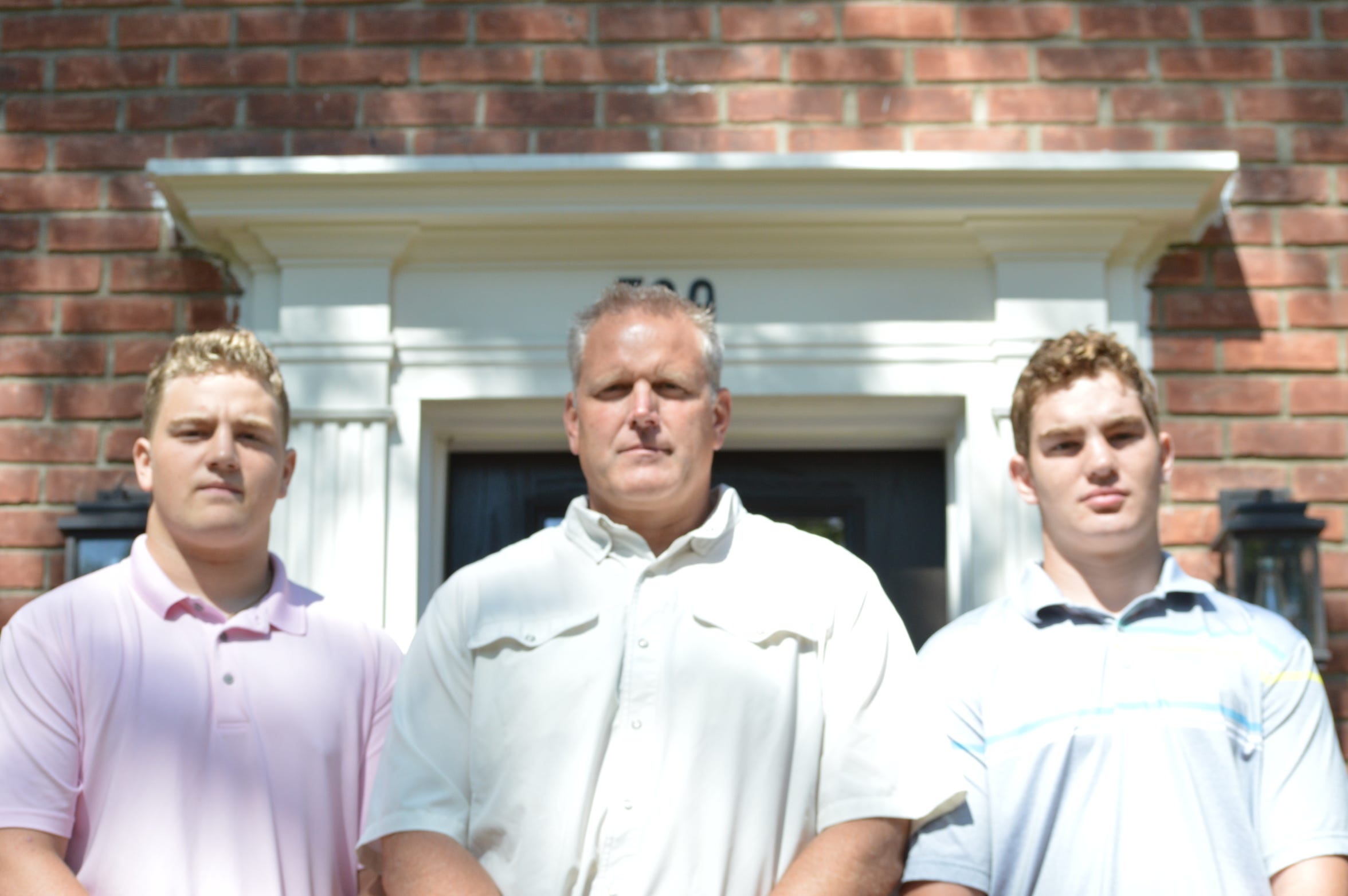 Jim DeWald, head coach at Birmingham Seaholm, stands with his two sons: Caden and James.