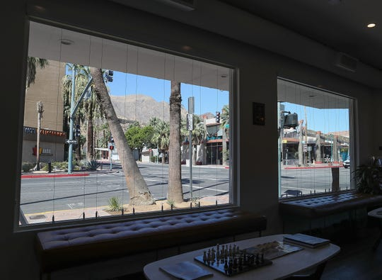 Windemere Real Estate in downtown Palm Springs was fined by the city for displaying real estate listings in their windows, they have since removed the lisitngs which were hanging on these wires in their windows, September 23, 2019.