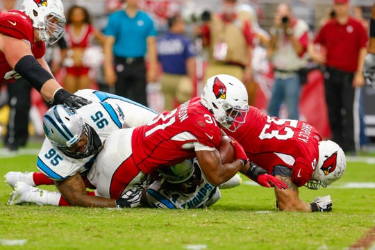 Arizona Cardinals Running Back David Johnson gets tackled by Carolina Panthers Nose Tackle Dontari Poe during the second half on Sep. 22, 2019 in Glendale, Ariz.