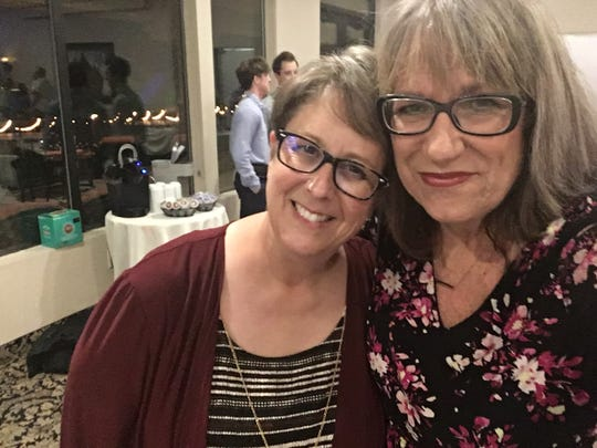 Amy Blodgett and Karina Bland in glasses at Amy's daughter's recent wedding. We hate glasses.
