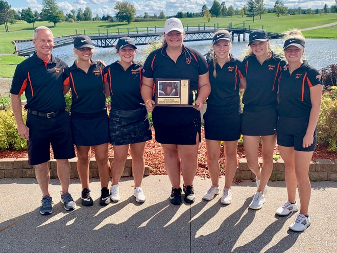 The Almont girls golf team won the Blue Water Area Conference championship Monday, Sept. 23, 2019, at Holly Meadows in Capac. Pictured are (l-r) coach Mark Bone, Maggie Henige, Jesse Hellebuyck, Riley Wranosky, Hannah Revoldt, Lydia Schlandere and individual champion Brandi Kautz.