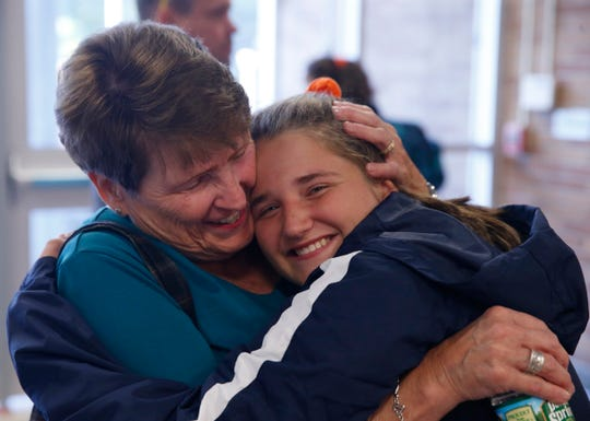 Theodosia Wilson gets a hug from her grandmother, Marlee following Friday's junior varsity volleyball game against Spackenkill on September 20, 2019.