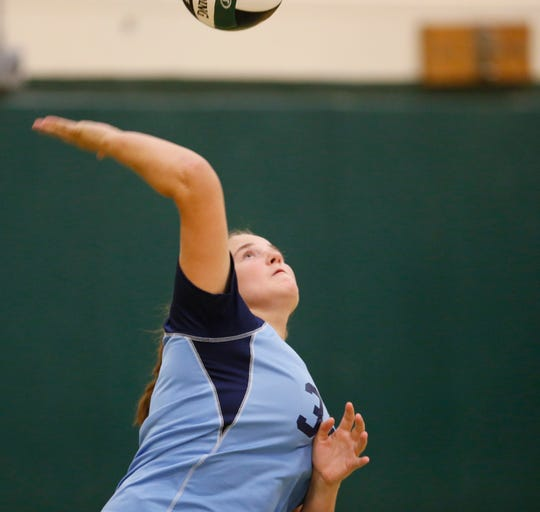 John Jay's Theodosia Wilson serves the ball during Friday's junior varsity volleyball game versus Spackenkill on September 20, 2019.