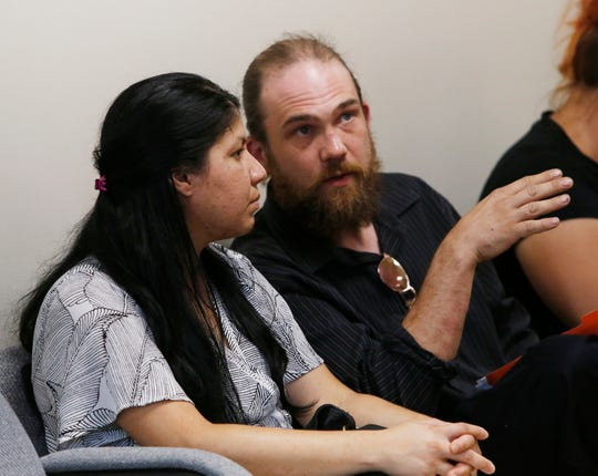 Cooper Road Mobile Home Park residents, from left, Ana Mendoza and Corey Hughes speak during Monday's hearing at the Dutchess County Office of Behavioral and Community Health about the  community's water issues on September 23, 2019. Residents in the community have been advised since Sept. 6 that the community's water disinfectant system is not functioning and they should not drink the tap water.