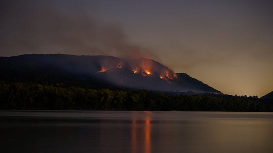 A blaze, seen from Denning's Point in Beacon, burns on Sugarloaf Mountain in Putnam County Friday night.