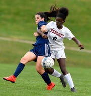 Dallastowns Victoria Smith, left, and Hershey's Damaria Wedderburn get tangled up while battling for the ball, Monday, September 23, 2019. John A. Pavoncello photo