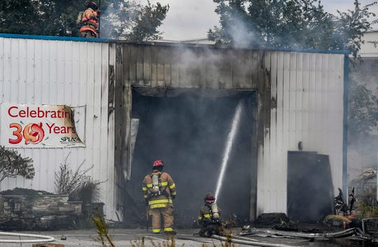 Firefighters battle a blaze at Splash Pond Supplies in the 1200 block of Toronita Street, Monday, September 23, 2019. 