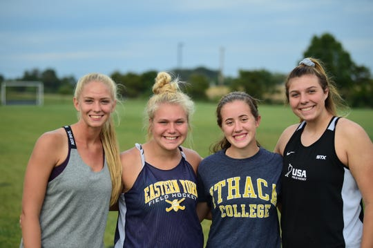 From left: Eastern York field hockey players Addison Malone, Haley Holtzinger, Claire Rumsey and Kelsey Felix pose for a photo after practice Monday, Sept. 23. Rumsey lost her stepmother, Michelle Buckius, this past August.