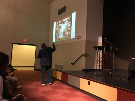 "Jeff Kirkland, one of four panelists, presents about the lack of quality affordable housing in the 1960s at the ""Perspectives on York's Racial Unrest"" forum at Logos Academy in York."