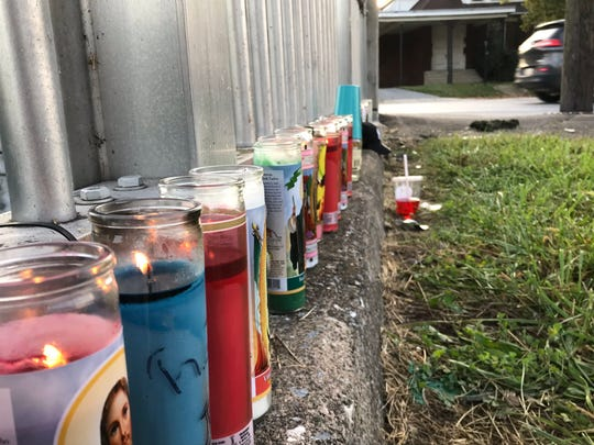 Candles are placed in the 500 block of North George Street in York where a man was found dead after a shooting early Sunday.